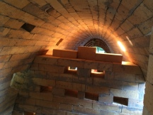 Checker wall to move the flame and create the smoke chamber. I cut all those angles and Kaitlin Eramo placed the bricks