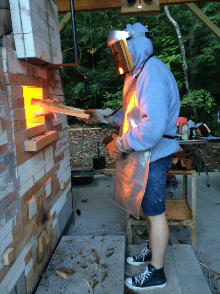 Josh Query front stoking the kiln during the dry fire
